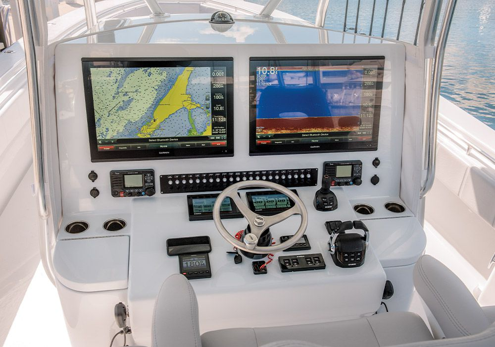 At the helm, a spacious dash holds twin MFDs and a complement of switches and controls.