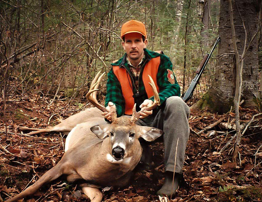 Hal Blood with a buck he grunted in during the rut amid several signpost rubs.