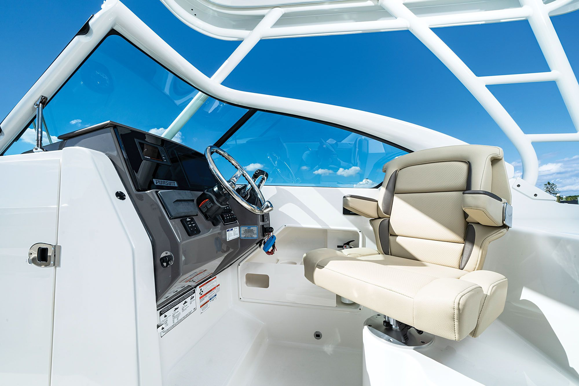 The helm seat swivels for easier interaction with the crew.