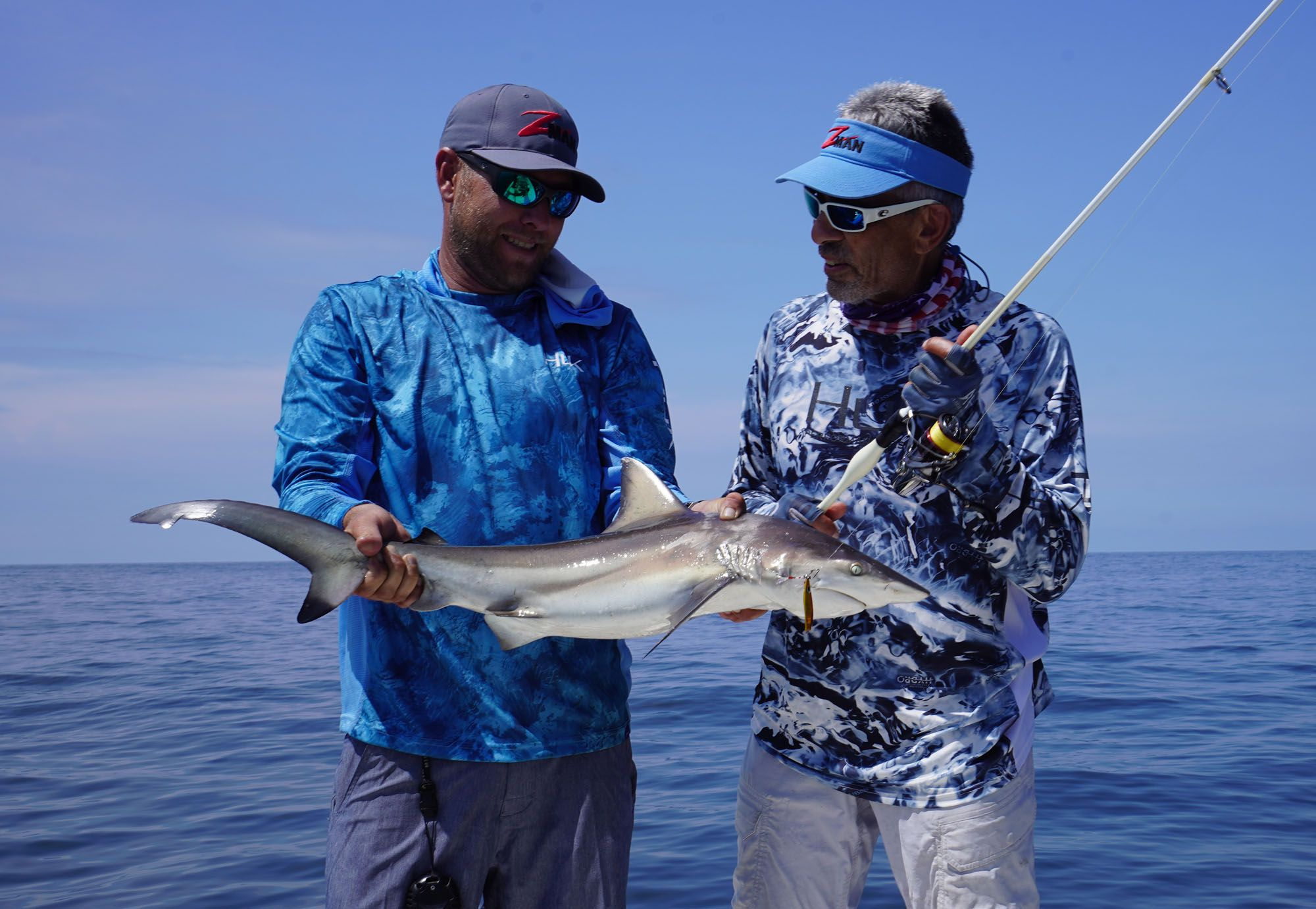 I just had to try a cast with a micro-jig, and the result was this blacktip that made a couple spectacular jumps and, on 12-pound braid, was a kick in the ass. Obiol is holding the fish.