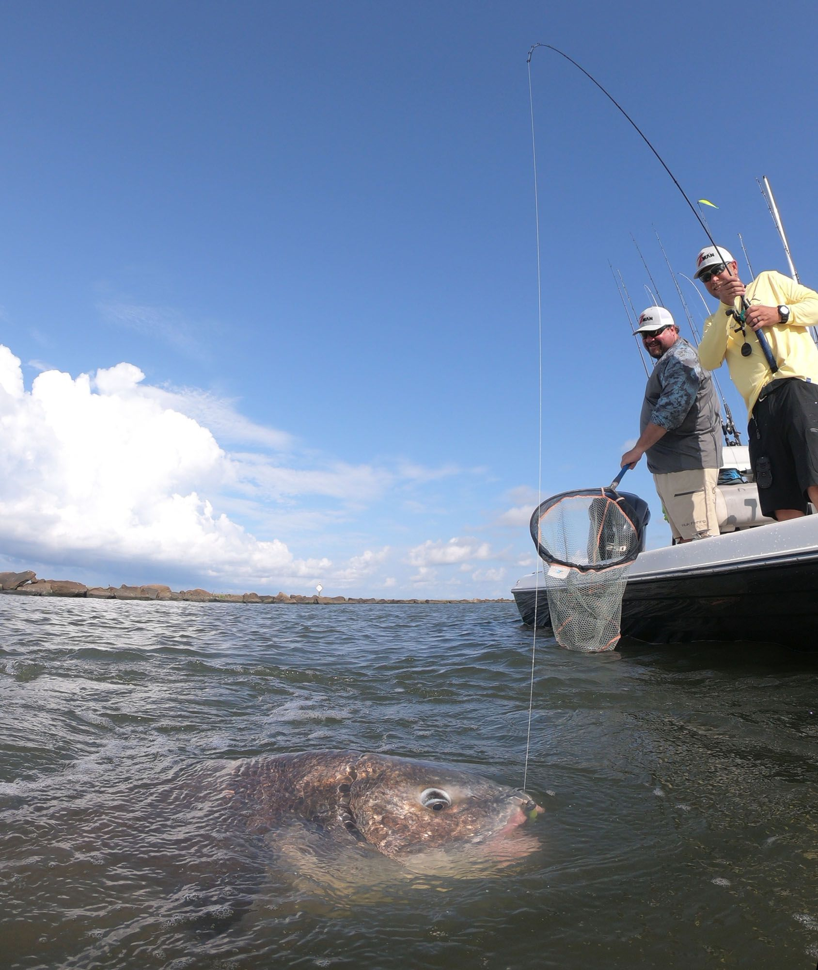 A few miles away, we had a bit of time left in fair skies before the rain caught up to us, so we make a few casts at the outer jetty, where Obiol quickly showed us how to hook a black drum on a Z-man bait.